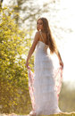 Bride hippie style stands outdoors spring park Stock Image