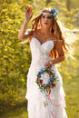 Bride hippie style stands outdoors spring park Stock Photo
