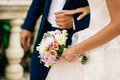 Bride hold wedding bouquet of rose peonies and roses Royalty Free Stock Photo