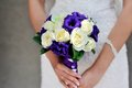 Bride hold wedding bouquet with white and lilac roses Stock Photos