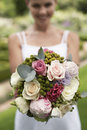 Bride holding beautiful bouquet of roses young in garden Stock Photography