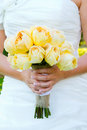 Bride holding bouquet flowers a beautiful in a white wedding dress holds her of in her hand on her wedding day Royalty Free Stock Images