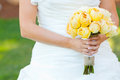Bride holding bouquet flowers a beautiful in a white wedding dress holds her of in her hand on her wedding day Stock Images