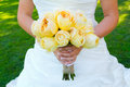 Bride holding bouquet flowers a beautiful in a white wedding dress holds her of in her hand on her wedding day Stock Image