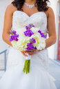 Bride holding bouquet flowers a in a white wedding dress holds her of on her wedding day Royalty Free Stock Photos