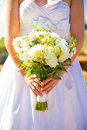 Bride holding bouquet flowers a in a white wedding dress holds her of on her wedding day Stock Images