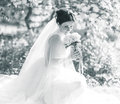 Bride holding the bouquet young wedding in a beautiful garden Royalty Free Stock Photography