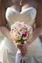 Bride holding flower bouquet shallow dof Royalty Free Stock Photo