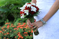 Bride holding her wedding bouquet Stock Images