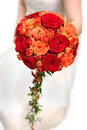 Bride holding orange bouquet Royalty Free Stock Image
