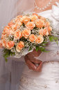 Bride holding orange bouquet detail Stock Photo
