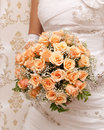 Bride holding orange bouquet detail Royalty Free Stock Photo