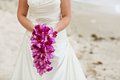 Bride Holding Purple Orchid Fl...