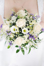 Bride holding wedding bouquet Stock Image