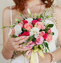 Bride holding wedding bouquet close up a Stock Photo