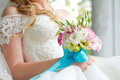 Bride holding wedding bouquet close up a Royalty Free Stock Photo