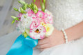 Bride holding wedding bouquet close up a Stock Images