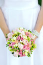 Bride holding wedding bouquet in hands Stock Photo