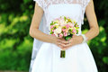 Bride holding wedding bouquet in hands Stock Images