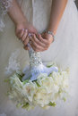 Bride holding wedding bouquet held by the Stock Images