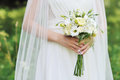 Bride holding wedding bouquet outdoor outdoors Royalty Free Stock Images