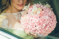 Bride holding wedding bouquet with pink flowers Royalty Free Stock Photo