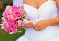 Bride holding wedding flowers a pink bouquet in her hands copy space Stock Photos