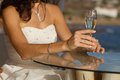 Bride holding wedding glass with wine Royalty Free Stock Photography