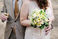 Bride holding yellow wedding bouquet Royalty Free Stock Images