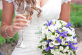 bride holds in hand glass of champagne and weddin Royalty Free Stock Photo