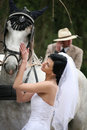 Bride with horses Royalty Free Stock Images