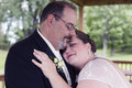Bride Lays Head on Grooms Shoulder Royalty Free Stock Photo