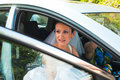 Bride leaving by car the ceremony Royalty Free Stock Images