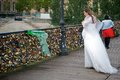Bride looking for her love padlock in a bridge over the seine river in paris france Royalty Free Stock Image