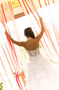 Bride looking out of window Stock Photography