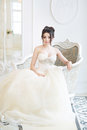 Bride in luxury interior in palace. Wedding, attractive brunette Royalty Free Stock Photo