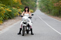 Bride on motorcycle in wedding dress Stock Images