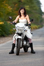 Bride on motorcycle in wedding dress Royalty Free Stock Image