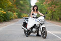Bride on motorcycle in wedding dress Stock Image