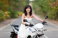 Bride on motorcycle in wedding dress Royalty Free Stock Photography