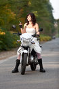 Bride on motorcycle in wedding dress Royalty Free Stock Photos