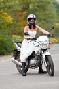 Bride on motorcycle in wedding dress Stock Photography