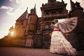 Bride near the ancient castle happy Royalty Free Stock Image