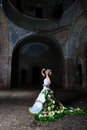 Bride in the old ruined church at night room of destroyed Royalty Free Stock Photography