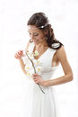 Bride with orchids in a white dress in a romantic scenery Royalty Free Stock Photo