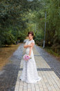 Bride in the park in the alley Royalty Free Stock Photo