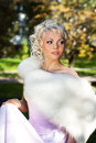 Bride in the park pink looks into distance Royalty Free Stock Images
