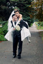 Bride piggyback on groom Stock Images