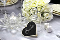 Bride place setting on wedding table close up of detail breakfast dining with a heart shape blackboard card for and glass Royalty Free Stock Photo