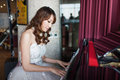 Bride is playing piano Royalty Free Stock Photos